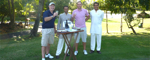 Mark and Stuart enjoying champers at Legend golf course at Belle Mare Plage Resort Mauritius