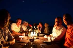 NI team enjoying dinner under the African starlit sky