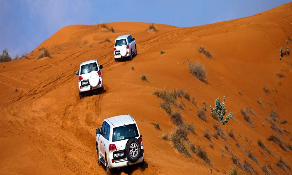 Dune bash in a 4x4 on a desert safari experience in dubai