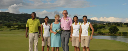 Chris and Jonquil Boyes on a Mauritian golf green with resort staff
