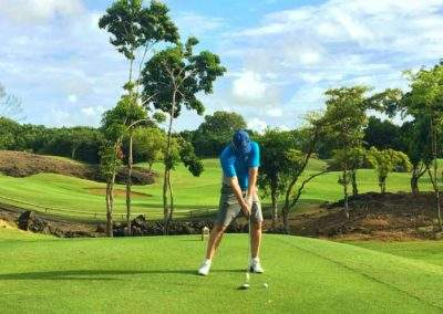 Mark teeing off on the Links Golf Course at Constance Belle Mare Plage Golf Resort, Mauritius