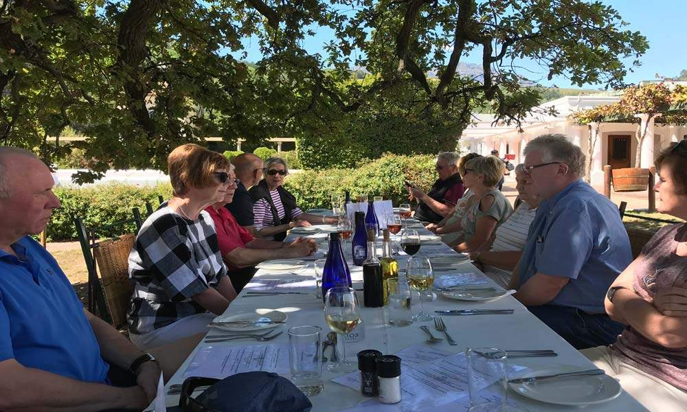 Lunch under the giant oak tree at Morgenhof Estate