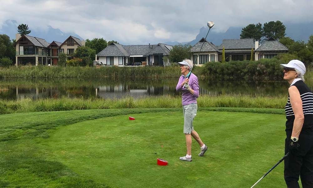 Jacques shares the golf course with two lady golfers